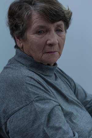 pensionary: Portrait of depressed old and lonely women Stock Photo