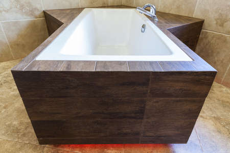 Modern bathtub in the bathroom in the residence photo