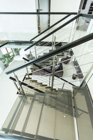 barrier: Modern glass staircase in the apartment
