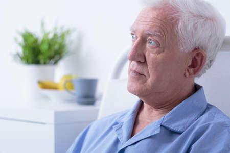 hospital patient: Senior afraid patient lying alone in hospital