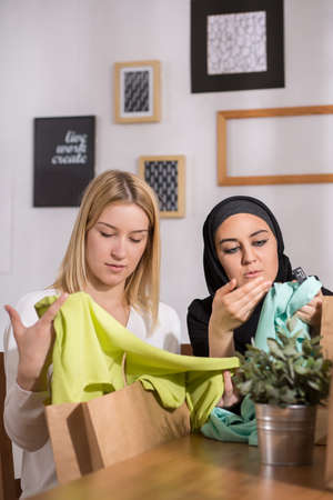 they are watching: Female friends watching new clothes, they bought during shopping