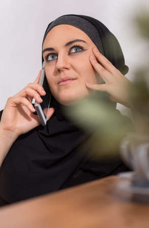 middle eastern ethnicity: Young muslim woman being on the phone Stock Photo