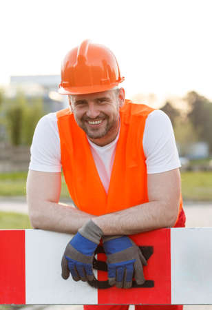 young worker: Smiling young handsome construction worker in uniform