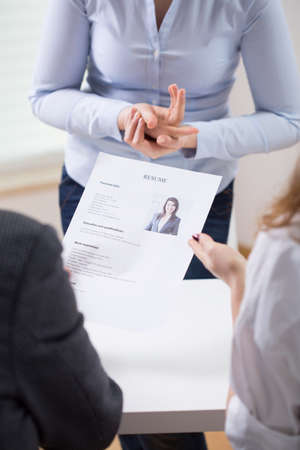 employers: Employers looking at a resume of a potential new worker Stock Photo
