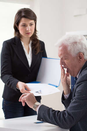 young woman talking to a manager about new job stock photo