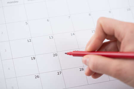 looking for work: Marking important interview in calendar with red marker
