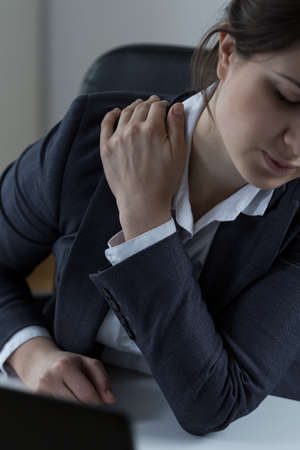 arm pain: Office worker with acute arm pain