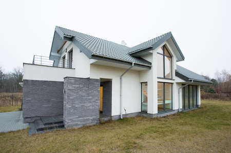 extravagance: Fancy design of new big residence with spacious lawn
