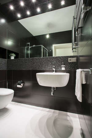 expensive granite: Photo of small exclusive black and white bathroom