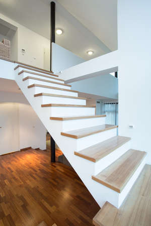 two level house: High wooden stairs without rails leading to the first floor