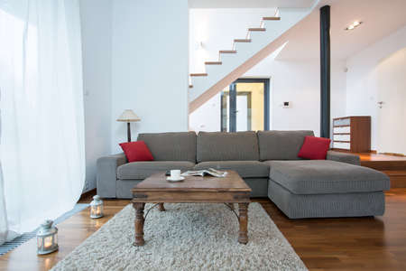 living space: Relax space with big comfortable couch and wooden coffee table Stock Photo