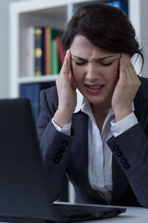 terrible: Office worker suffer from terrible cephalalgia