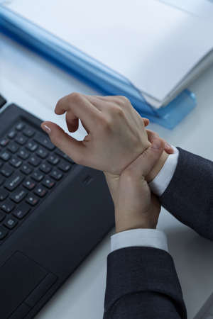 carpal tunnel syndrome: Office worker with carpal tunnel syndrome Stock Photo