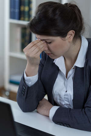 worries: Office worker suffering from sinusitis Stock Photo