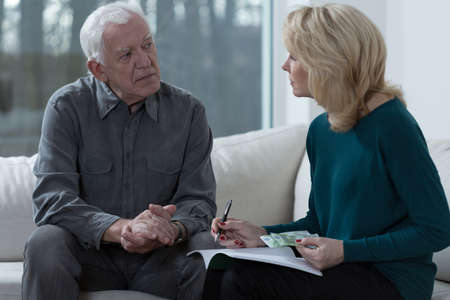 difficulties: Old marriage sitting and solving financial difficulties Stock Photo