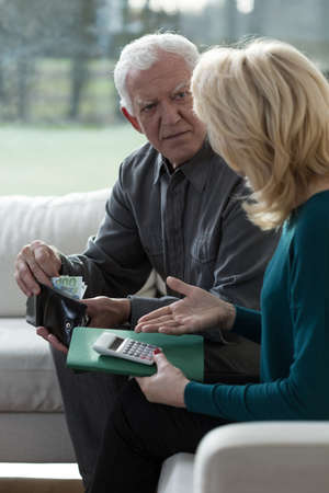 overcome: Elderly couple try to overcome financial difficulties Stock Photo