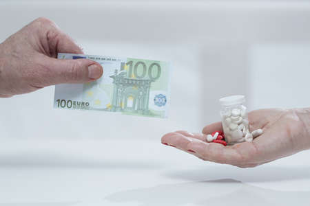 pay for: Struggling to pay for medications and hospital bills Stock Photo