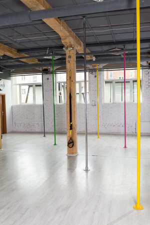 dance studio: Picture of color pylons in pole dance class