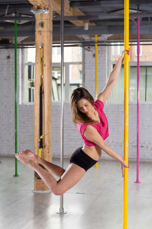 sexy girl dance: Image of young woman during pole dance training