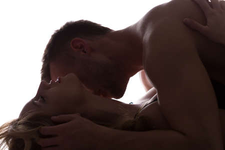 Sexy lovers kissing and playing in bed