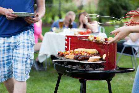 backyards: Friends having nice fun on grill party