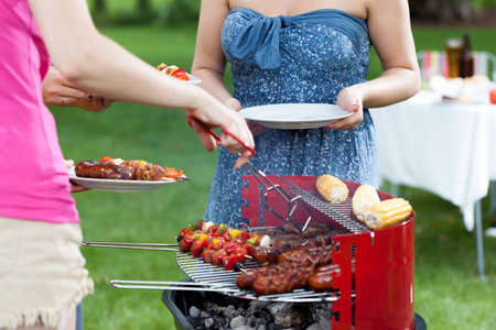 frazzled: Host serving grilled meals on barbecue party