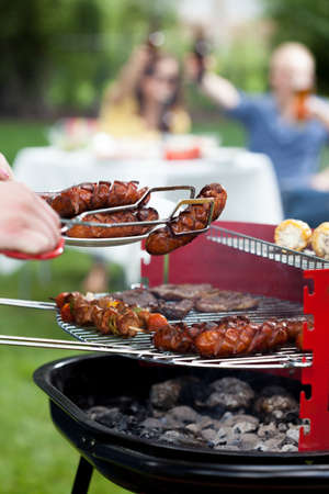 frazzled: Closeup of barbecue with grilled sausages and shishkebabs