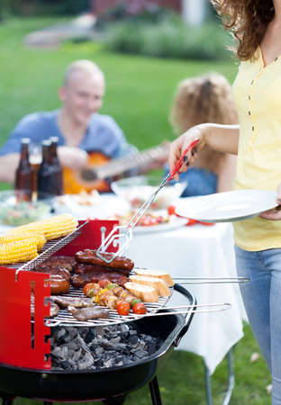 frazzled: Vertical view of barbecue party in garden Stock Photo