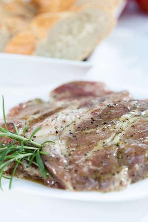 seasoned: Closeup of seasoned porkneck prepared on grill