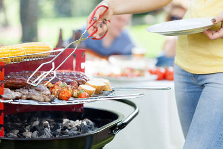 meat grill: Woman serving grilled steak on garden party