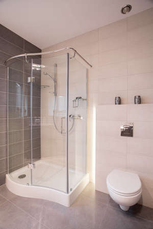 Glass shower and porcelain toilet in new bathroom Stock Photo