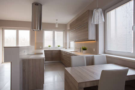modest: Big modest wooden kitchen in modern residence