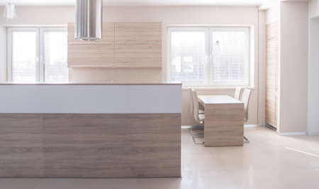 kitchen  cooking: Big wooden island in new modern designed kitchen