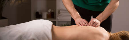 Woman in beauty resort during her spinal column mobilization