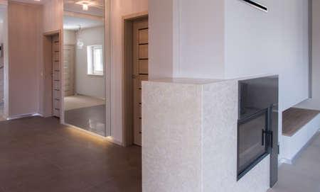 anteroom: Spacious empty hallway with big mirror on wall Stock Photo