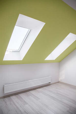 slanting: Simple empty room at the attic with slanting window