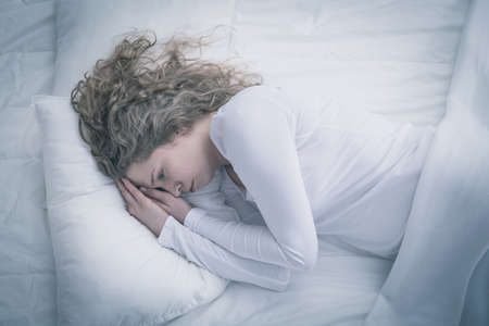 despairing: Woman with depression spending day in bed
