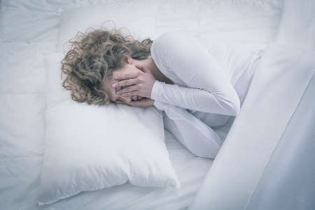 sleeping: Picture of depressed woman sleeping all day