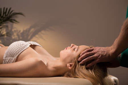 sensual massage: Young beautiful woman relaxing on her head massage