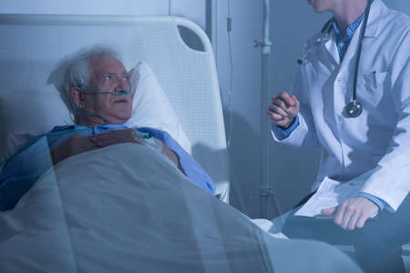 the sick: Physician talking with sick elderly man about treatment