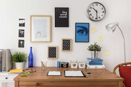 home office interior: Well prepared materials for work on wooden desk