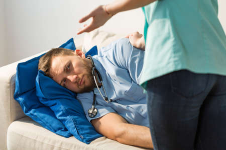 doctor stress: Tired doctor does not want to do anything Stock Photo