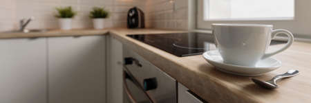 Porcelain coffee cup on the wooden worktop photo