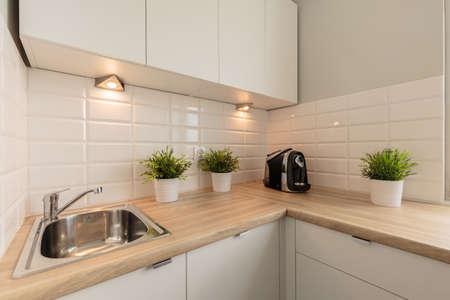 worktop: Flower pots on the worktop in cozy kitchen