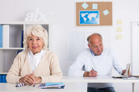 Image of senior students sitting at the desk photo