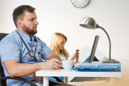cheerless: Medical personnel is resting in emergency room Stock Photo