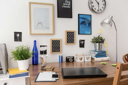 desk tidy: Nice stylish pictures on wall above desk in office