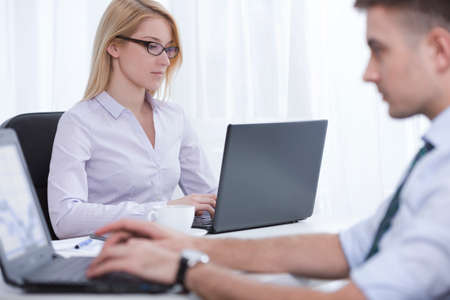 Photo of two employees working in corporation Stock Photo