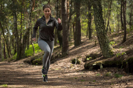 jogger: Image of active jogger running in nature