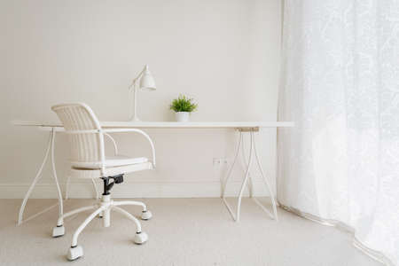 minimalist apartment: White empty desk in stylish retro interior